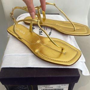 LIKE NEW! Prada flat leather t-strap sandal (gold)